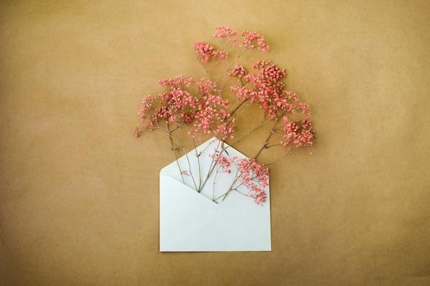 Postal envelope with pink flowers inside