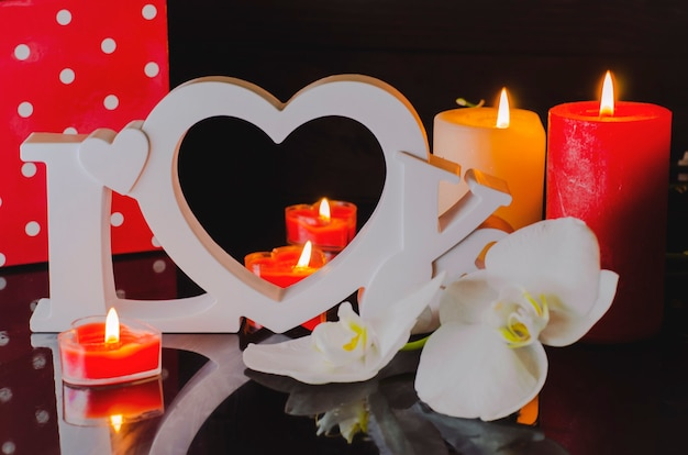 Postcard to the day of all lovers or valentine's day in the form of the word love