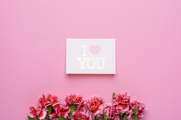 Postcard i love you with pink flowers on pink