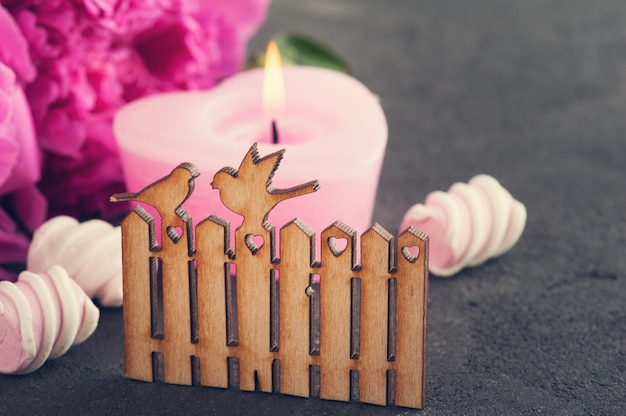 Postcard with wooden gate and birds, peony flowers, candle