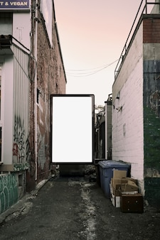 Poster billboard on city dirty alley background .blank advertising billboard mockup in the street