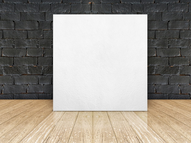 Poster frame at black brick wall and wooden floor
