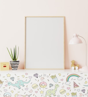 Poster frame mockup in children's room standing of chest of drawers with funny kids print, with light pink wall on background, 3d rendering