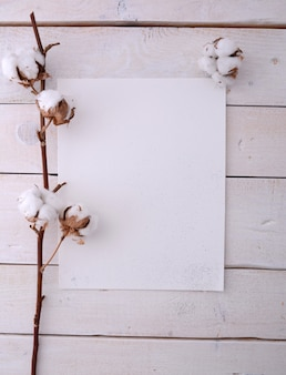 Poster frame mockup with cotton flowers