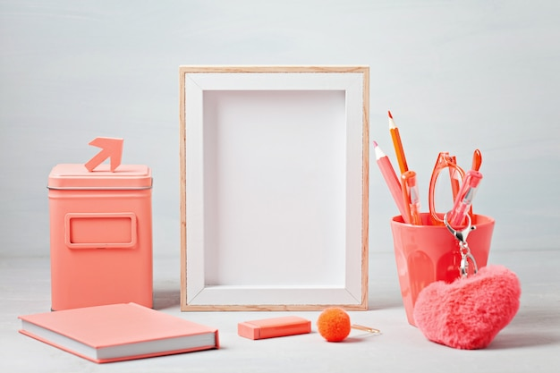 Poster frame with decor elements in living coral color