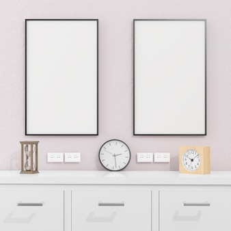 Poster frames in living room and cabinet with clocks