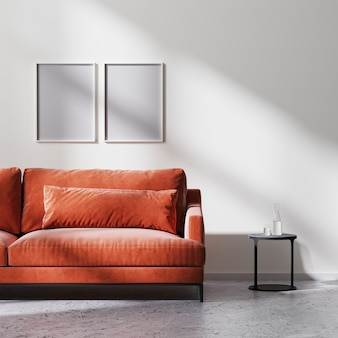 포스터 프레임은 빨간색 소파, 태양 광선이 있는 흰색 빈 벽이 있는 검은색 커피 테이블, 원시 콘크리트 바닥, 스칸디나비아 미니멀리즘 스타일, 3d 렌더링으로 조롱합니다.