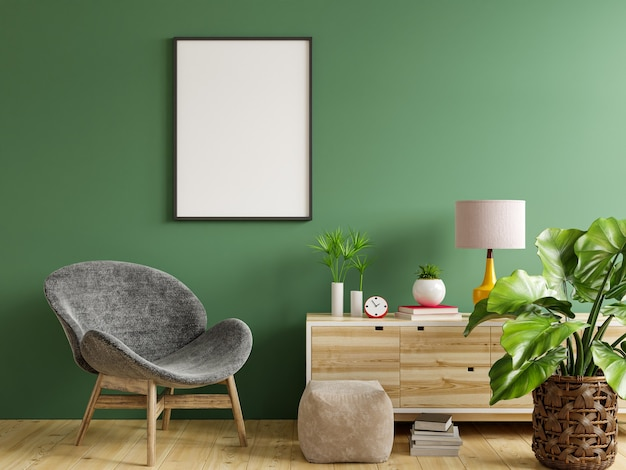 Poster mockup with vertical frame on empty green wall in living room interior with gray velvet armchair.3d rendering