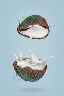 파란색 배경에 코코넛 반쪽과 우유가 튀는 이미지가 있는 포스터