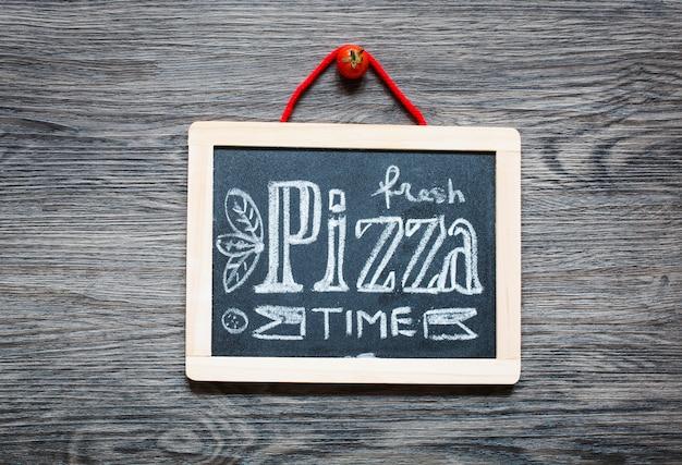 Poster with pizza stylized chalk inscription