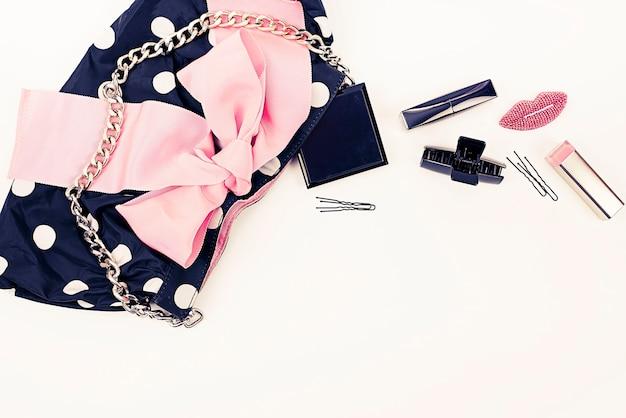 Poster women's handbag with decorative cosmetics.