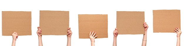 Posters of cardboard in his hands. isolated on white. set. copy space.