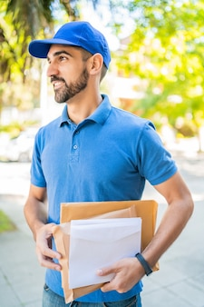 Postman carrying packages and letters