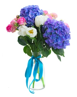 Posy   of white tulips, pink roses  and blue hortensia flowers   isolated on white space