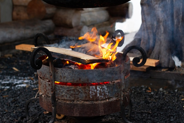 Pot on the fire, the concept of wild camping . cooking in nature during a hike.