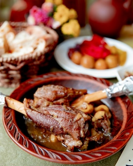 Pot roast meat served with pickles