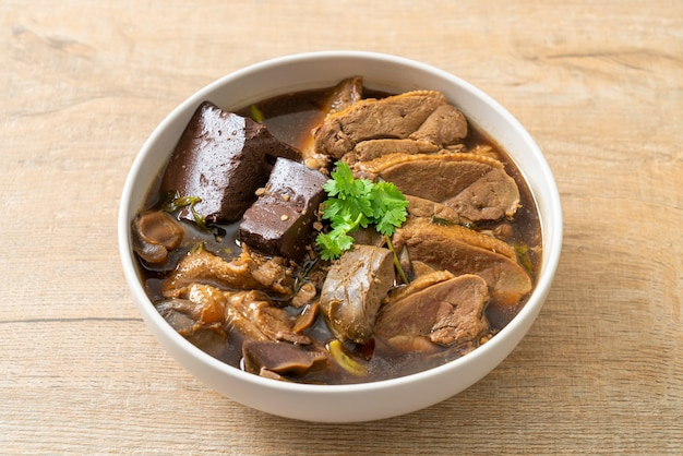 Pot-stewed ducks or steamed duck with soy sauce and spices - asian food style