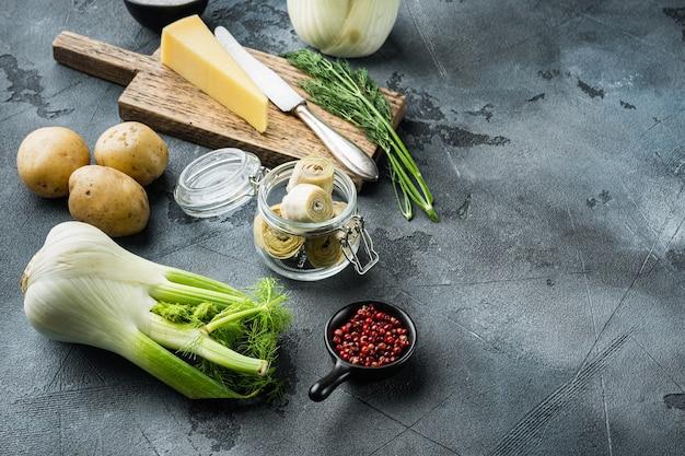 Картофель и артишок al forno ингредиенты, на сером фоне с пространством для текста