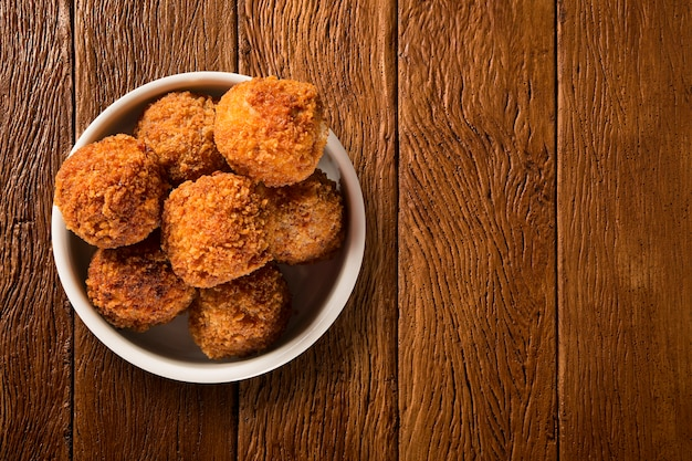 Potato ball fried portion on the wood background