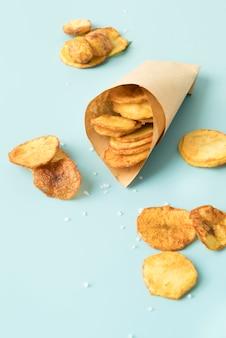 Potato chips on blue background