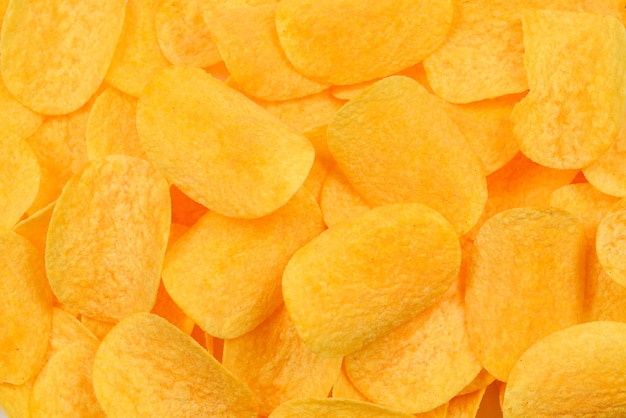 Potato chips snack texture background. top view.