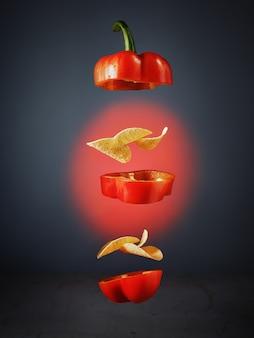 Картофельные чипсы с паприкой. концепция левитации еды