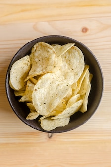 Potato chips on wood: snack in break time