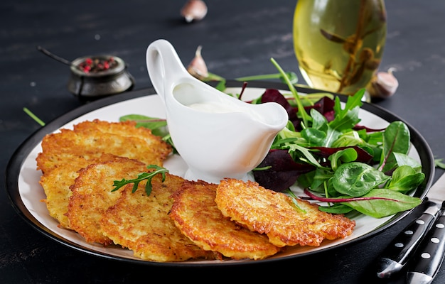 Potato fritters served with sour cream