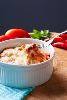 Potato gnocchi with tomato and cheese sauce.