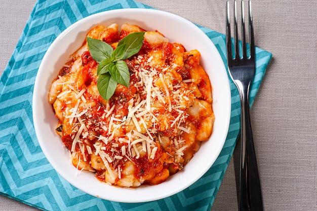 Potato gnocchi with tomato and cheese sauce