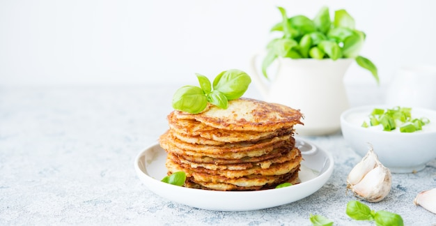 Potato pancakes with herbs and sour cream, russian, belarusian cuisine, copy space