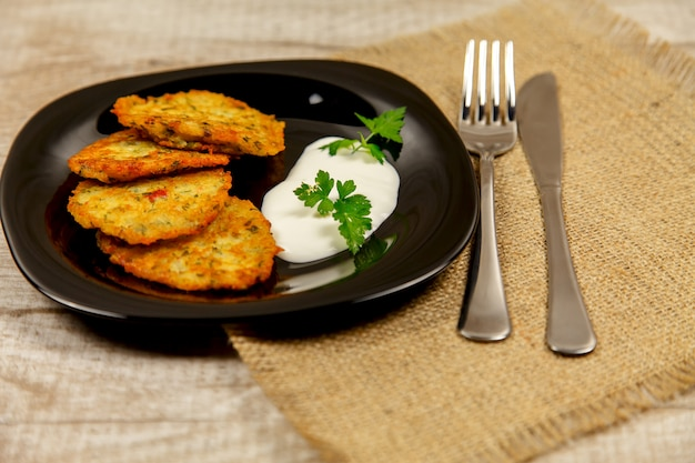 Potato pancakes with sour cream and parsley