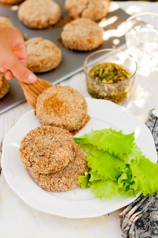 Potato and pork patties with salad leaves