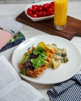 Potato salad with vegetables and orange juice
