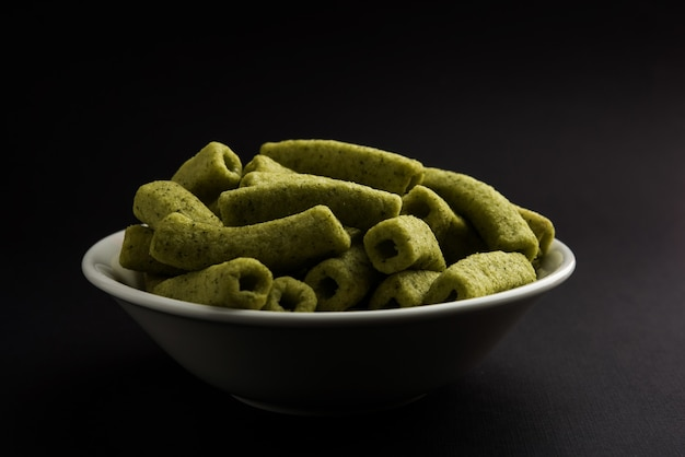 Potato stick is crispy snacks in plain and spinach flavour in hollow square macaroni shape