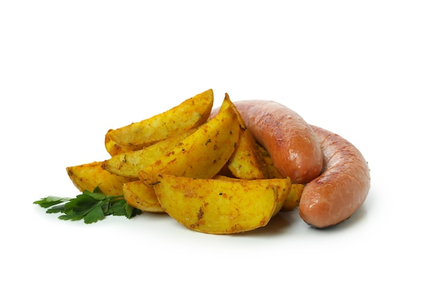 Potato wedges and fried sausages isolated on white background