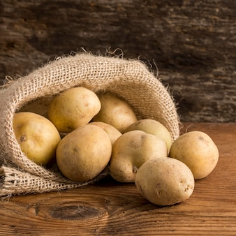Potatoes arrangement in canvas sack bag