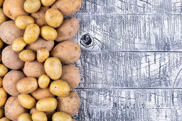 Potatoes on a gray wooden table