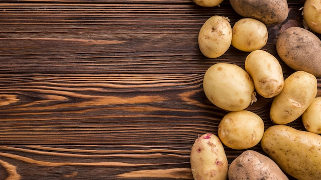Potatoes on table with copy-space