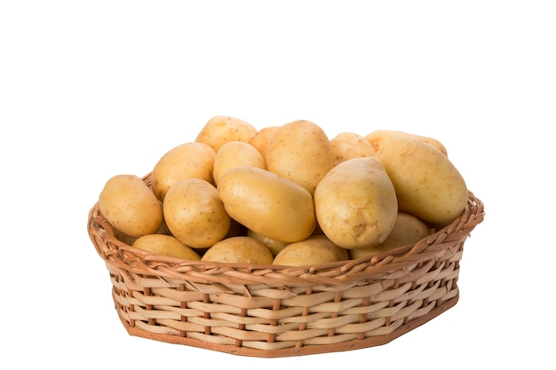 Potatoes in wicker basket on white background