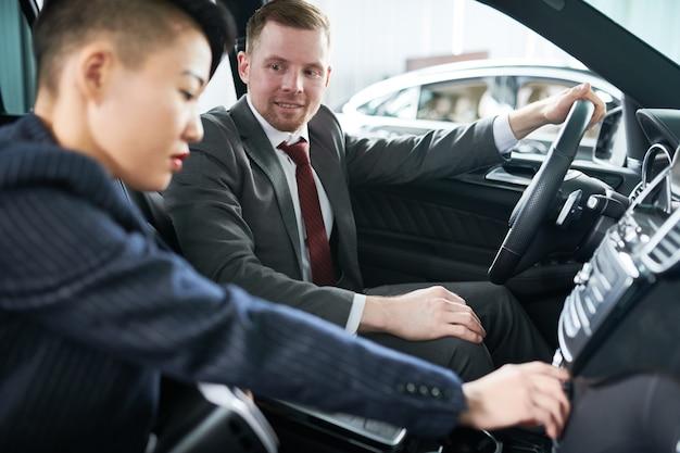 Potential customer examining new car