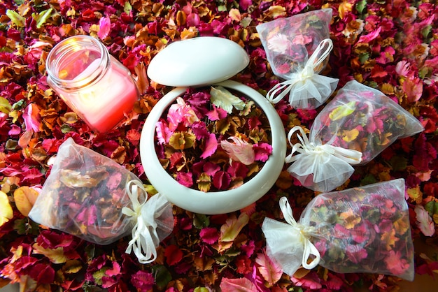 Potpourri or dried petals flowers colorful and scented candles