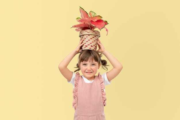 Potted plants and kid studio shoot