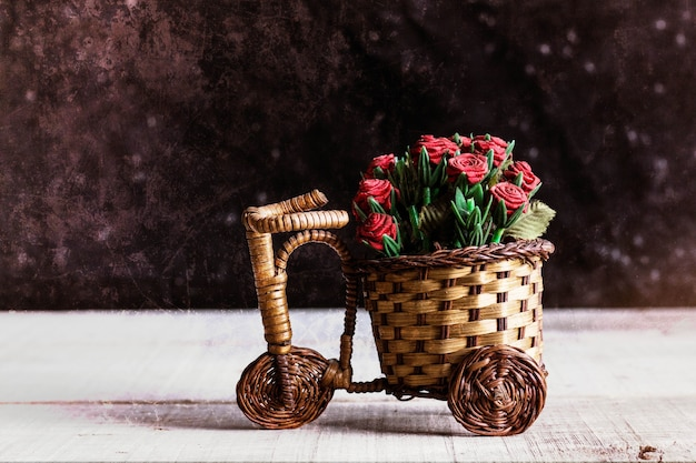 Potted roses on bike.