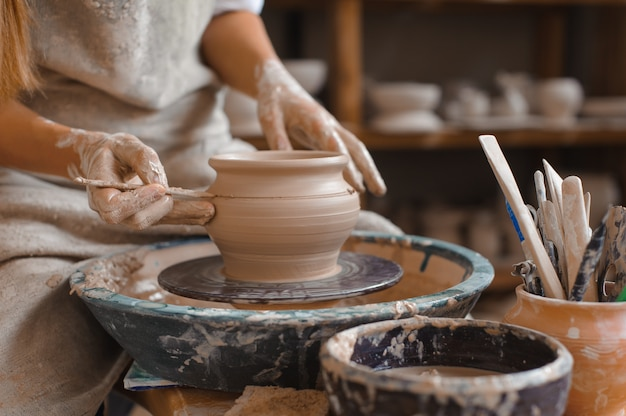Potter teaches how make clay pot