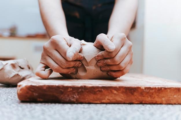 Potter works in a workshop
