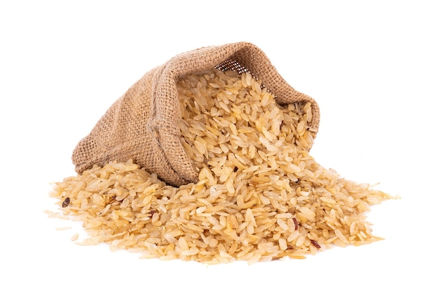 Pounded unripe rice in jute sack isolated on white surface