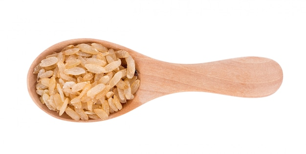 Pounded unripe rice in wooden spoon