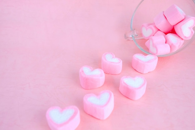 Pour out marshmallow from coffee cup, love background