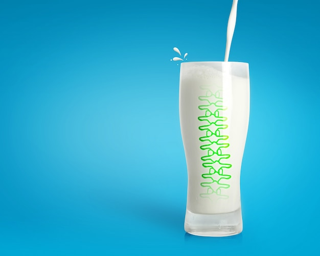 Pouring fresh milk in glass with strong spine on blue background. healthy drink background.
